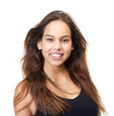 Portrait of a beautiful young woman smiling on isolated white background — Stock Photo