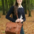 Young woman walking outside on a beautiful fall day  — Stock Photo
