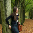Happy woman standing outdoors and relaxing on a autumn day — Stock Photo