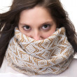 Portrait of a young woman with scarf covering face — Stock Photo