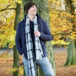 Attractive young man standing outdoors on an autumn day — Stock Photo