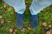 Standing on green grass outdoors — Stock Photo