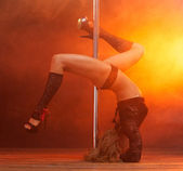 Portrait of a beautiful female dancer performing striptease — Stock Photo