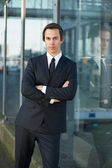 Young businessman standing outdoors — Stock Photo