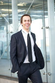 Portrait of a smiling businessman walking in the city — Stock Photo