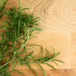 Close up fresh rosemary branches on cutting board — Stock Photo #37002529