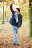 Young man relaxing outdoors on an Autumn day — Stock Photo
