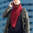 Portrait of a trendy man talking on mobile phone — Stock Photo