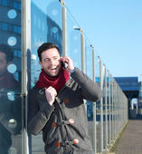 Happy man laughing on mobile phone outdoors — Stock Photo