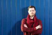 Handsome young man with sweater and scarf — Stock Photo