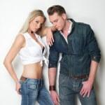 Young fashion couple posing against white background — Stock Photo
