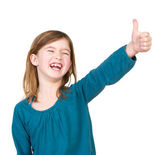 Portrait of a young girl laughing with thumbs up — Stock Photo