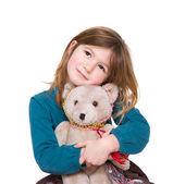 Cute girl hugging teddy bear — Stock Photo