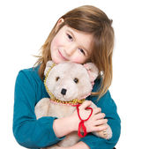Cute girl holding teddy bear — Stock Photo