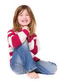 Young girl sitting and laughing — Stock Photo