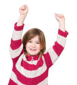 Adorable young girl with arms raised in success — Stock Photo