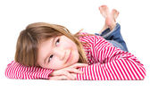 Young blond girl lying on floor — Stock Photo