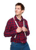 Casual guy holding suspenders and looking away — Stock Photo