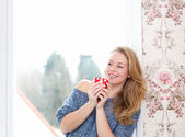 Relaxing by window with a cup of tea — Stock Photo