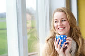 Young woman smiling with cup of tea — Foto Stock