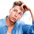 Handsome young man thinking — Stock Photo