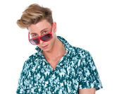 Young man looking over sunglasses — Stock Photo