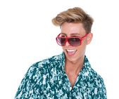 Young man laughing with sunglasses  — Stock Photo