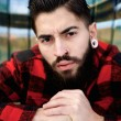 Stock Photo: Young guy with beard and piercings