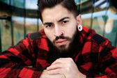 Young guy with beard and piercings — Stock Photo