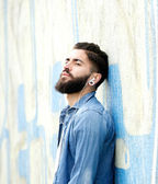 Man with beard listening to music — Stock Photo