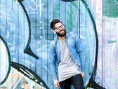 Smiling man with beard and glasses — Stock Photo