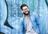 Man with beard and glasses laughing — Stock Photo