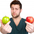 Young man with two apples — Stock Photo