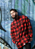 Male fashion model with beard posing against graffiti wall — 图库照片
