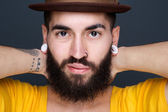 Man with beard and piercings  — Stock Photo