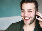 Man smiling using mobile phone — Stock Photo