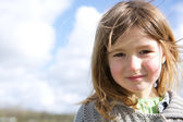 Girl smiling outdoors — Stock Photo