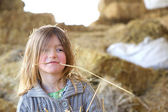 Cute kid with straw in mouth — Stock Photo