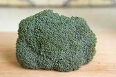 Broccoli on wooden cutting board — Stock Photo