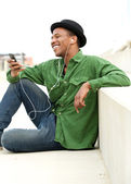 Young man listening to call on mobile phone — Stock Photo