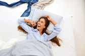 Portrait of a smiling woman awake in bed — 图库照片