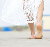 Barefoot woman walking away — Stock Photo