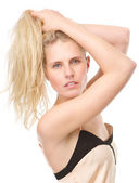 Sensual young woman posing with hands in hair — Foto Stock