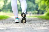 Female walking in running shoes outdoors — Stok fotoğraf