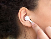 Female ear with earphone  — Stock Photo