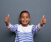 Happy little boy showing thumbs up — Stock Photo