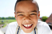 Portrait of a smiling little boy with suspenders — Stock Photo
