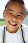 Young boy smiling with suspenders — Stock Photo