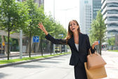 Businesswoman with raised arm calling for taxing — Stock Photo