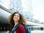 Woman smiling with backpack  — Stock Photo